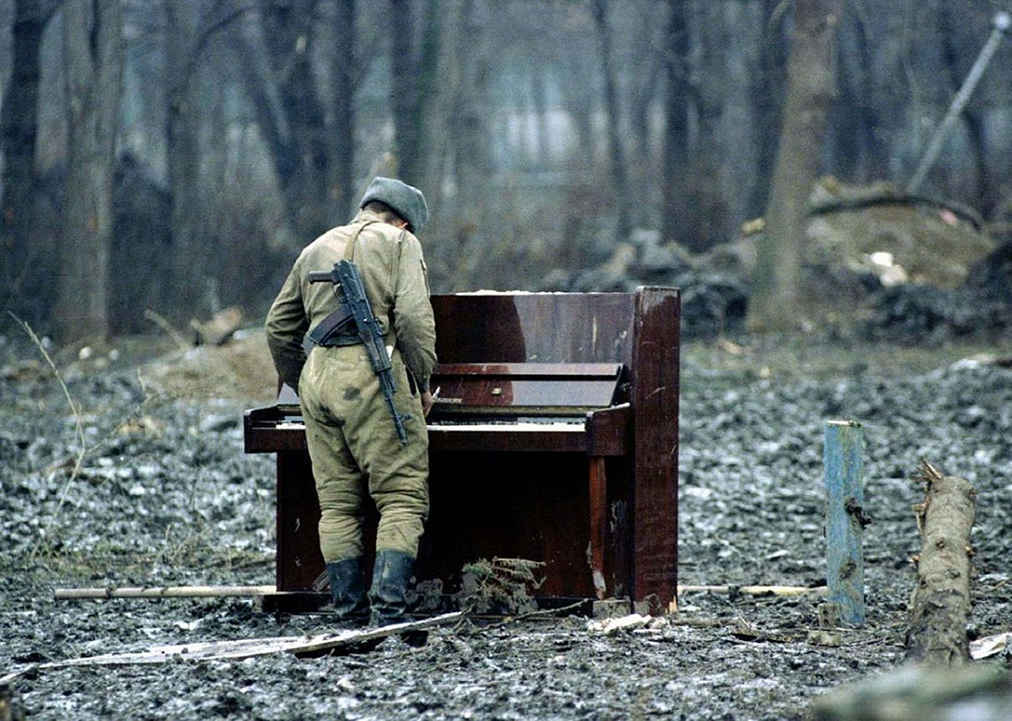 Russian soldier playing an abandoned piano-cecenia